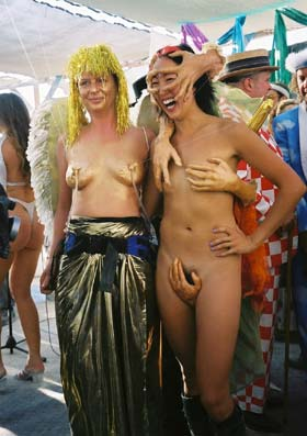 Fountain of Youth & Multi-Handed beauties - Notice the spraying nipples on the golden girl at Burning Man 2001.  To edit your record, em Editor@CostumeNetwork.com